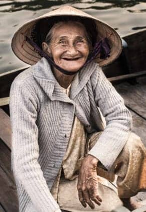 Elder Vietnamese lady. Private Hoi An, Da Nang & Hue tours with Man Nguyen